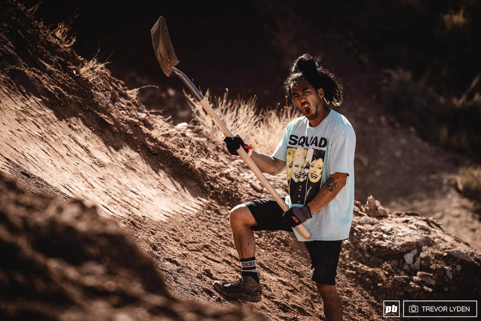 Damon Iwanaga rockin out while digging.