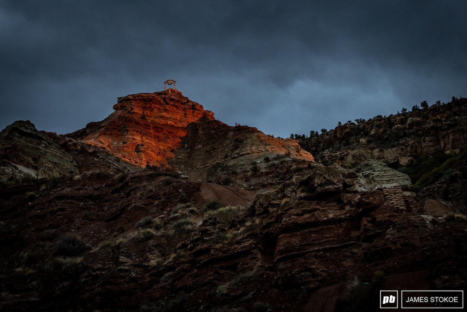 The sun managed to peek through the storm clouds for just a second at sunset to light up the start gate with a glow that makes the red rock pop like no other place.