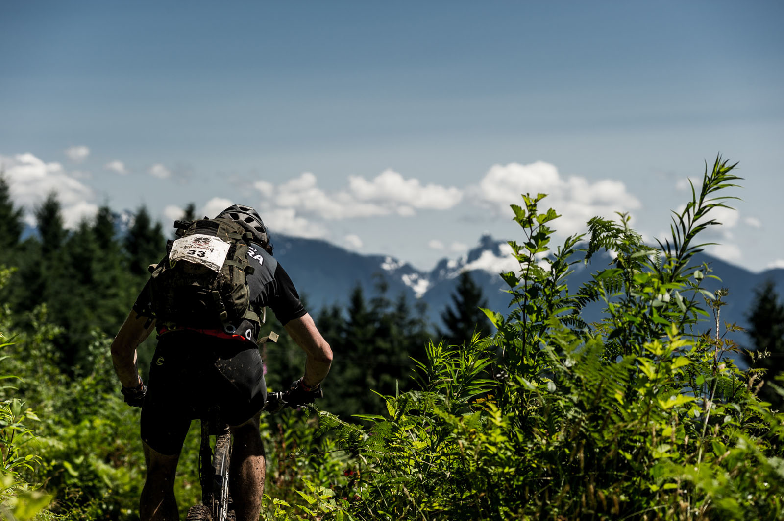 Riders take in a view of the Coastal Mountains between singletrack shreds.