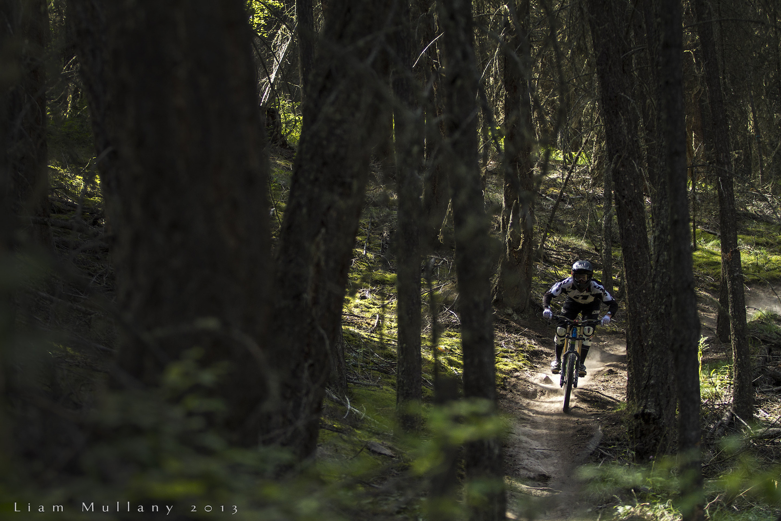 """Kirk pounding through a pocket of late afternoon sunshine on the fast and loose trails on Harper Mountain for his episode of """"Over the Edge."""""""